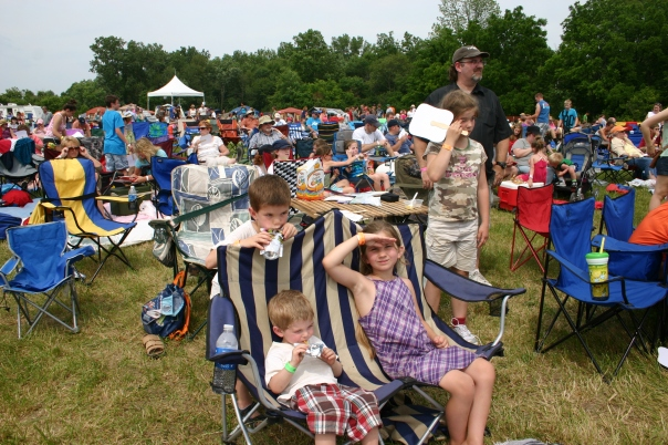 Observe the hot children covered in 3 bottles of sunblock.