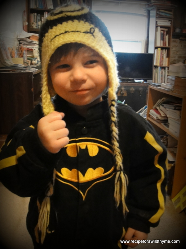 "Me: ""Why are you holding your fist up?"" Seth: ""I'm Batman getting ready to punch somebody.""  Yep...that cute face with the Minion hat is SO intimidating! LOL!"